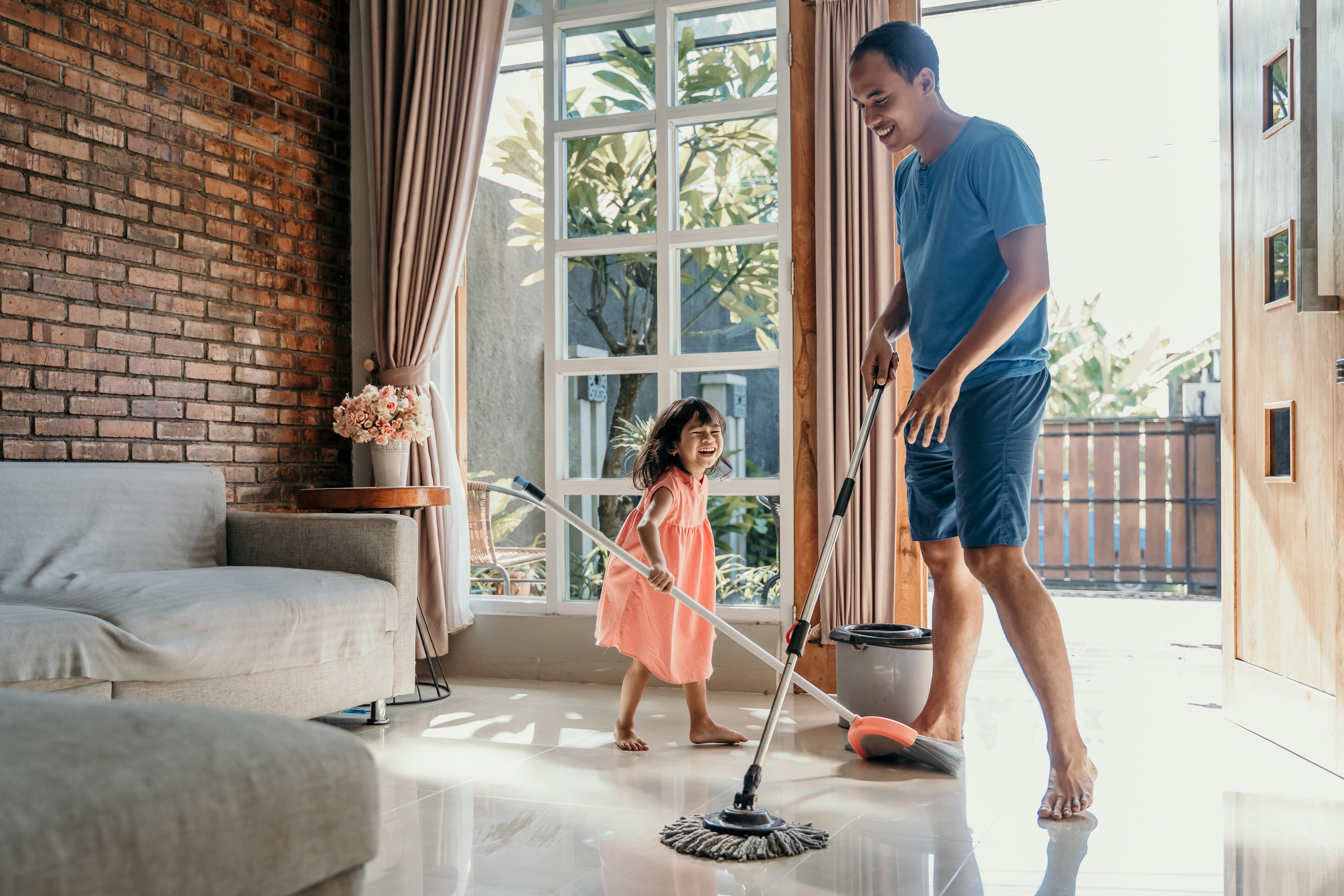 Dad and kid cleaning the floor